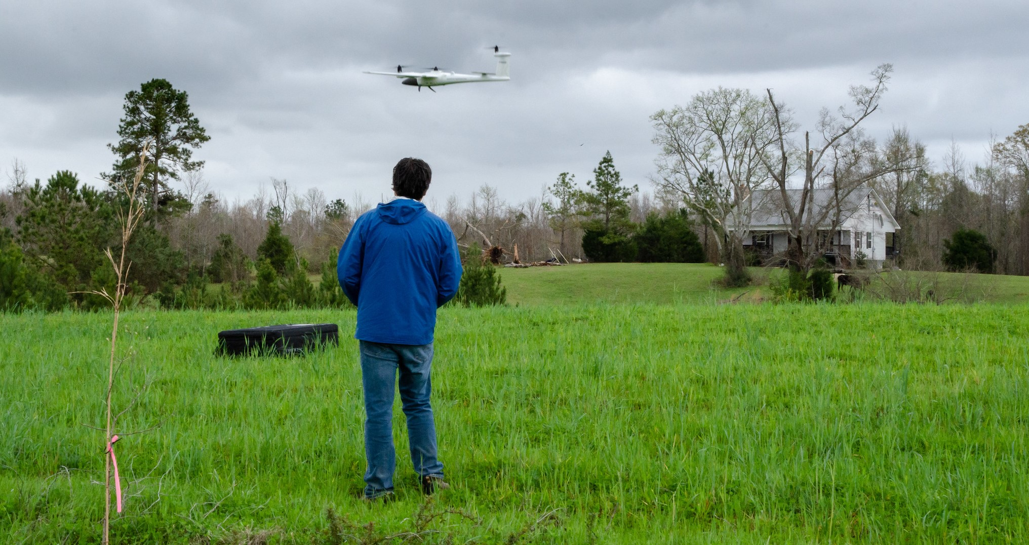 A researcher with the NOAA National Severe Storms Laboratory flies a drone near tornado damage in Alabama in April 2021. Scientists hope aerial images of tornado paths of destruction can better characterize high-wind damage to vegetation and in rural areas to improve disaster response and recovery.